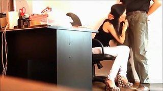 Hidden cam films a slim secretary blowing a big boss's cock