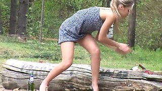 hot blonde drunk in the woods pee on the grass