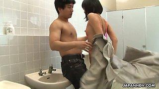 Crazy Asian chick Uta Kohaku pisses on dick of one stranger dude in a public toilet