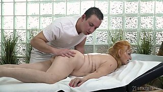 Lewd busty old whore gives masseur a blowjob before doggy fuck