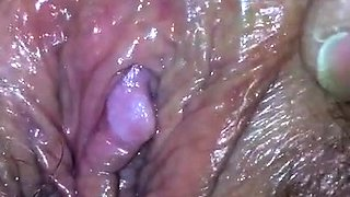 My wife rubbing her dreaming wet pussy and clit