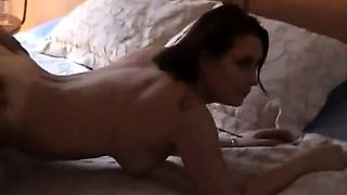 Stacked brunette wife gets used by two guys on the bed