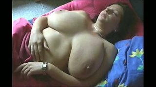 My big boobed girlfriend loves playing with her big knockers