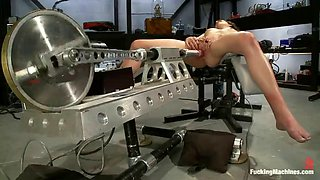 kinky brunette gets nailed by a machine