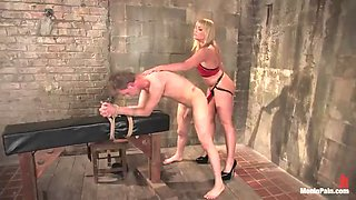 dominatrix pegging on a guy before putting a strapon on his face for sex
