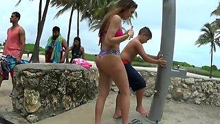 Sexy teen latina waits for beach shower