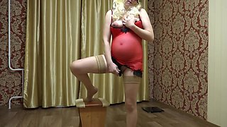 slender pregnant milf masturbates with dildo