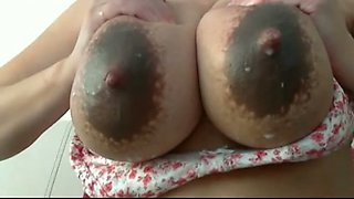 Solo clip with my lactating spouse playing with her big tits