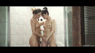 Gorgeous lesbo babes in the shower finger the clit
