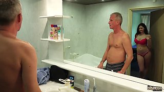 A hot busty babe seduce an older fellow in a bathroom and let him fuck her in multiple poses