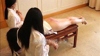 Traditional paddling asian punishemnt