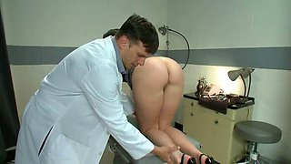 Naughty doctor gives the beauty an enema